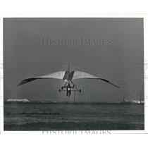 1975 Press Photo Glider In Air Over Field. - hcx04669