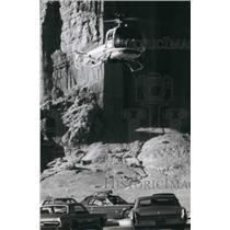 1967 Press Photo Helicopter Rose Over Cougar To Take Camera Shots of Canyon