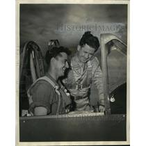 Press Photo Two men at cockpit of a airplane - sba17782