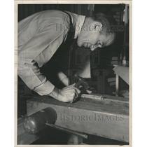 1949 Press Photo Man Binding A Book With A Hammer - RRW48597