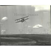 1979 Press Photo Crop-duster flying over an open field - spb07665