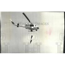 1976 Press Photo Region VI firefighting crews climb down ropes from helicopters.