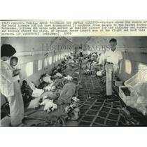 1975 Press Photo Inside of the world Airways DC8 jet transports 55 orphans