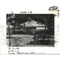 1982 Press Photo Workmen Repair Roof after Pan Am Flight 759 Crash in Kenner, LA
