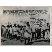 Press Photo Algerian rebels group stage march members