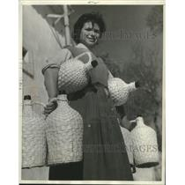 1957 Press Photo Portugal - Custom-tailored Jugs all wrapped in wicker