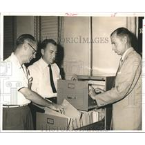 1955 Press Photo Officials Looks Though City Land Scandal Records in Houston.