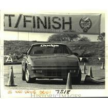 1987 Press Photo Contestant Drives Car--National Collegiate Driving Championship