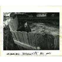 1993 Press Photo Reni Bloch stands by her fence being eaten by Bonnabel Canal