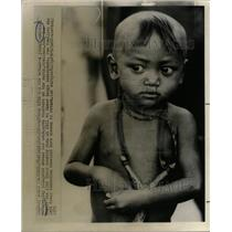 1967 Press Photo Refugee Eyes Young Cambodian neck toy - RRX72423