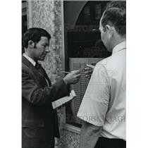 "1973 Press Photo ""Redcoat"" Eugene Price Hands Citation for Littering"