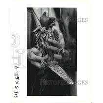 1993 Press Photo Peregrine Falcon transported with protective hood for calming.