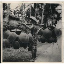 1939 Press Photo An Indonesian peddler walks the streets of Bali selling goods