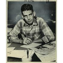 1955 Press Photo John P. Foley, Jr. takes notes from newspaper - nob06138
