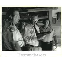 Press Photo Sen. John Breaux holds assault weapon at Municipal Training Academy