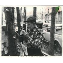 1952 Press Photo Frank Schmitt taking a call from rescue squad's radio.