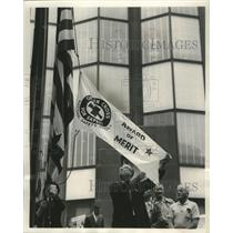 1950 Press Photo Fred Salmon raises pennant at A.O. Smith Corp. flagpole.