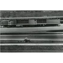1976 Press Photo Birmingham, Alabama: Airports: Municipal, Mower cutting Grass