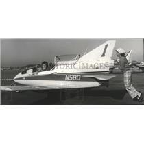 1975 Press Photo J. W. (Corkey) Fornof, in Plane, Mrs. Carolyn Wiltsie pushing