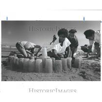 1987 Press Photo Kids Build A Sand Castle in Galveston Beach in Texas.