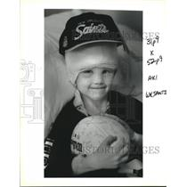 1993 Press Photo Christopher Gordon smiles in the hospital with autographs