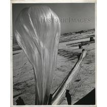 1950 Press Photo Technician Checks Flow of Gas Into New Balloon at its Base
