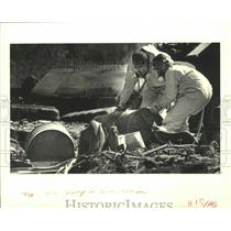 1988 Press Photo Peterson-Riedel Services workers move barrels of chemicals