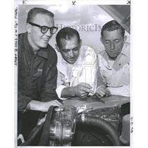 1956 Press Photo Drivers inspect engine at track - RRQ30707