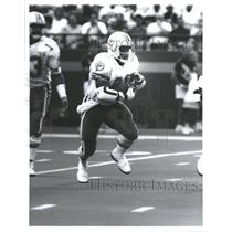 Press Photo Miami Dolphins Player Higgs Running Ball - RRQ61977