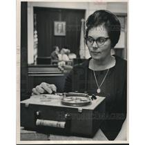 1965 Press Photo Mrs. Leon Snyder left council meeting with tape recorder