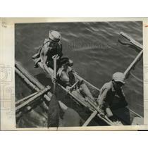 1945 Press Photo Young Filipino Boy greet U.S Soldier aboard Coast Guard LST