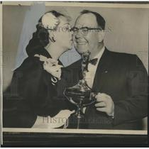 1958 Press Photo James Harrington gets kiss from wife after receiving award