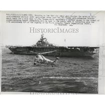 1959 Press Photo Anti Submarine Warfare helicopter past battleship Tarawa