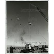 1963 Press Photo A cameraman man covers the First Las Vegas Meet of parachutists