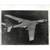 "1969 Press Photo Russian built ""Bedger"" Jet Bomber flies over American Carrier"