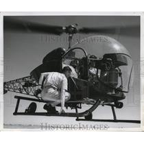 1956 Press Photo H-13H Bell helicopter changing pilots during Endurance flight