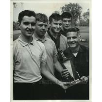 1966 Press Photo Father Frank Trainer and golf team First Place trophy Marquette