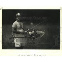 1986 Press Photo Louis McCarthy with model helicopter in inverted hover position
