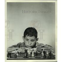 1955 Press Photo Young man concentrating on chess game, picture wins contest.