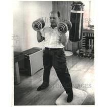 1962 Press Photo Perez Jimenez Works Out With Bar Bells In His Home Gymnasium