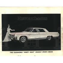 1963 Press Photo Woman Shows Oldsmobile 'Ninety Eight' Holiday Sports Sedan