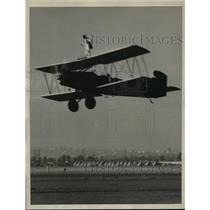 1933 Press Photo J. D. Pate stands on a plane during National Air Races