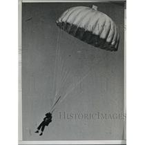 1944 Press Photo  Harry Pape lands safely on his parachute after plane accident
