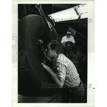 1987 Press Photo Technician inspect aircraft tire at Goodyear in Danville, VA