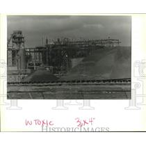 1994 Press Photo Piles of gypsum sit in the foreground of the IMC-Agrico plant.