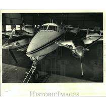 1986 Press Photo Three large planes in the hangar, Baton Rouge municipal airport