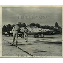 1949 Press Photo Ground Men Check Lt Price Plane After Returning From Flight
