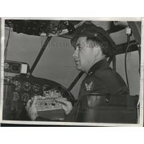 1945 Press Photo Major Douglas Whittaker controls the pilotless C-45 flight