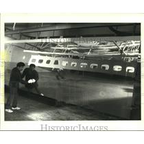 1987 Press Photo Northrop Corporation Tech Finishes Jetliner Panel, California