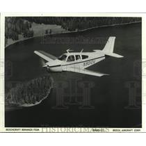 1970 Press Photo The Beach craft Bonanza F33A plane flies smoothly over sea